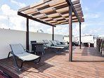 common areas rooftop with lounge chairs
