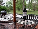 Our back patio overlooks open fields and offers a private spot for coffee or a glass of wine!
