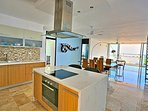 Open Kitchen Design with Marble Countertops and great ocean and Cozumel view from the living room