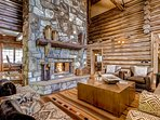 The ornate mantle and fireplace are the true focal point of the living room if you can take your eyes off the log