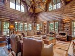 The living room has towering high ceilings and plenty of windows to let in that natural light.