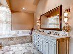 A walk-in shower, soaking tub and dual sink vanity make the master bathroom incredibly luxurious.