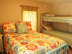 """""""Jenny Lind"""" bedroom has a full bed and a twin/twin bunkbed.  Dresser with mirror included."""