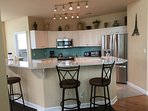 Upgraded kitchen with granite counters and stainless steal appliances.