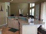 Kitchen bar has 4 bar stools.
