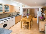 Large open plan Kitchen and dining room leading to  sitting room