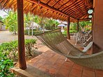 Lounge in the comfortable hammock with a cold beverage in hand.