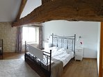 King Size Bed with additional single bed. Double aspect with en-suite shower room.