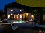 Pool & villa by night