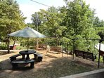 Picnic area, Grill, and bank of swings on the top tier.