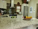 Large fully equipped kitchen with granit countertop.