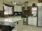 Fully equipped kitchen with stove, oven, fridge with freezer and dishwasher,
