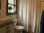 Full bathroom with bath and shower