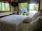 Same bedroom showing the ocean view and direct access to the balcony with sliding patio door.