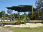 Playgrounds and free beachfront BBQs across the road from complex.