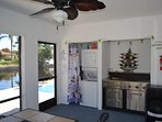 Stack washer and dryer. Screened in Lanai with wet bar and cook top with outdoor refrigerator.