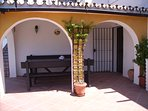 Spanish arches provide a shady corner
