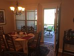Past the eating area is the screened patio, complete with lighted ceiling fan!