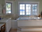 Soak in luxury with this spa tub in the master bath - with an incredible view.