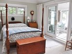 The spacious master suite features a sunroom and luxurious private bath.