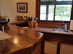 Fully furnished kitchenette with double hot plate, microwave, toaster oven, fridge, propane grill