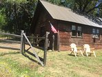 original ranch BunkHouse with a rustic exterior, an updated cozy country interior w/ clawfoot shower