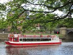 The riverboat cruises by Postern Close.