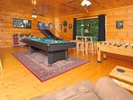 Foosball, basketball and  board games round out this entertaining game room.