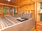 Main floor master with four poster king bed and Jacuzzi tub.Full bath en-suite.