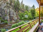 The huge 40' covered deck overlooks both Rapid Creek and the rugged canyon wall