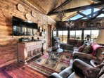 Entertainment Wall in Great Room. Guitars, Fiddle, Dobro & Piano for your use.