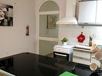 Fully equipped kitchen with microwave, oven and grill