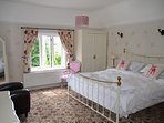 Pink bedroom with Menai views has ensuite with bath and separate shower