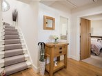 The bright hallway welcomes you into our charming period cottage