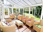 Plenty of space to sit and relax in the conservatory in the warmer months.
