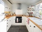 Our bespoke kitchen has beautiful Emma Bridgewater and Denby pottery, a belfast sink and dishwasher