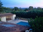 view of the pool, the pool house and the Luberon mountains from a bedroom upstairs