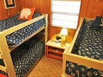 Four single beds in bunk room