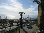 Vista desde el balcon hacia la bahia de valparaiso y caleta de pescadores de caleta portales.