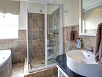 WHALE unit. En suite bathroom on 2nd bedroom. Bath and shower. WC and basin.