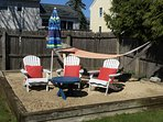 Beach chair with umbrella and hammock in sandbox
