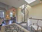 The spiral staircase gives the condo a unique flair.