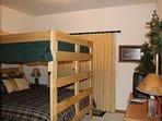 Buffalo room with queen over queen bunk bed--sliding glass door to patio