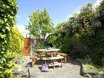 Enclosed sheltered rear courtyard garden