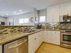 Modem kitchen with stainless steel appliances.