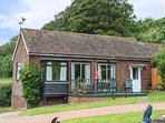 MONKS COTTAGE, detached bungalow with decked garden and off road parking, Favers