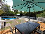 Backyard  pool, propane grill and deck