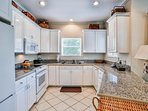 FIRST Floor kitchen with refrigerator, stove, oven, microwave, dishwasher and small appliances