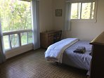 Master Bedroom with picture window. Watch the ships and Trowbridge lighthouse at night.