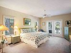 Spacious Master Bedroom opens to deck and pool